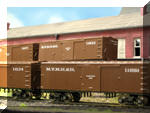 Recently completed conversion of old AHM trainset quality boxcars to good-looking layout-quality New Haven cars