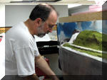 Scott works hard on getting the new scenery forms colored and coated with ground foam.