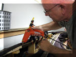 Ted uses the heavy-duty hot glue gun to fill a gap in the splines.